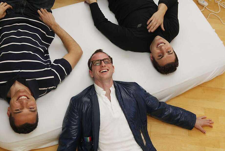Airbnb co-founders Nathan Blecharczyk (left), Joe Gebbia and Brian Chesky  have changed the balance of power in the accommodations industry by allowing someone with a spare room to create a peer-powered business. Photo: Mike Kepka, The Chronicle