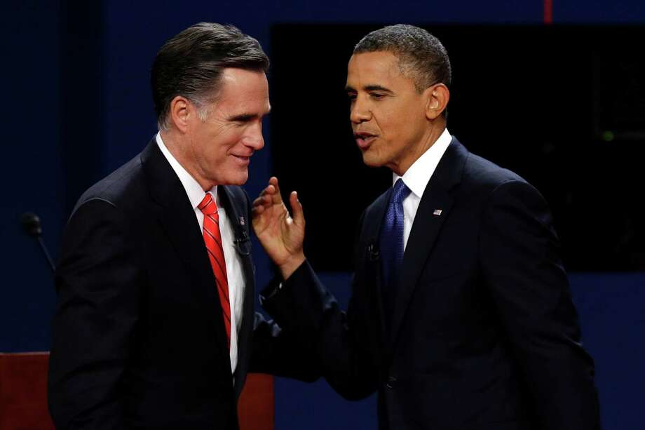 Republican Mitt Romney (left) and President Barack Obama talk after the first presidential debate at the University of Denver in Denver. Photo: Charlie Neibergall, Associated Press / AP