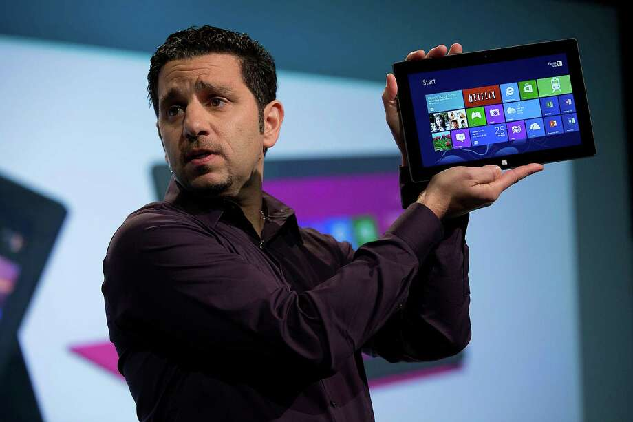 Panos Panay, general manager of the Surface team at Microsoft, displays the company's Surface tablet computer Thursday in New York. The new version of Windows comes out Friday as well as the tablet. Photo: Scott Eells