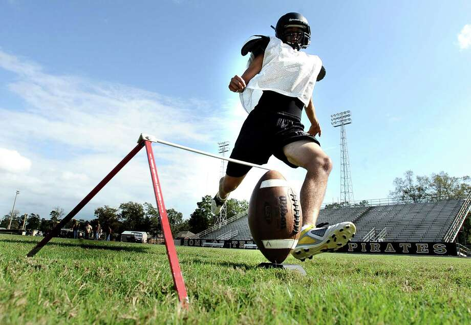 Vidor High School kicker Michael Tamayo, junior, practices kicking field goals for the homecoming football game against Port Neches-Groves that will be held on Friday, October 25, 2012 in Vidor. Photo taken: Randy Edwards/The Enterprise Photo: Randy Edwards