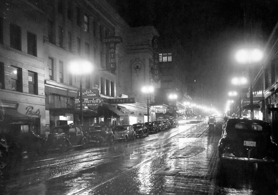 This is Fifth Avenue on Dec. 12, 1941, the night of a blackout, according to notes at MOHAI. The Coliseum, now Banana Republic, is slightly left of center. Photo: MOHAI, Seattle-Post-Intelligencer Collection