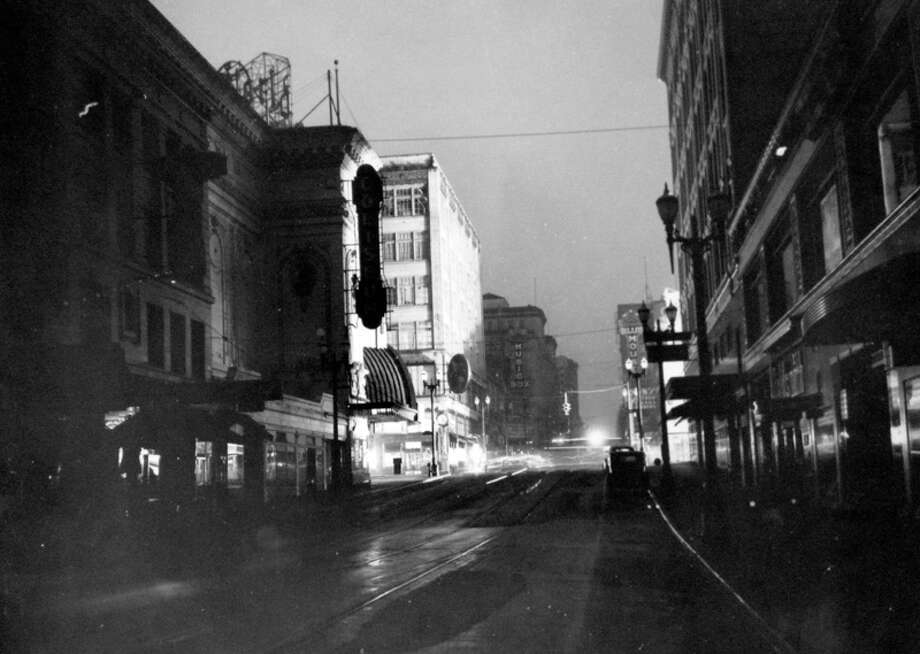 This is Fifth Avenue during the blackout, Dec. 12, 1941, according to notes at MOHAI. The Coliseum, now Banana Republic, is slightly left of center. Photo: MOHAI,  Seattle-Post-Intelligencer Collection
