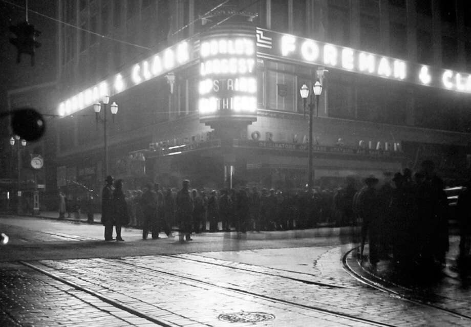 This picture at Fourth Avenue and Pike Street was taken in December 1942 during a blackout night, according to notes at MOHAI. The Forman and Clark building is now home to Ben Bridge. Photo: MOHAI, Seattle-Post-Intelligencer Collection