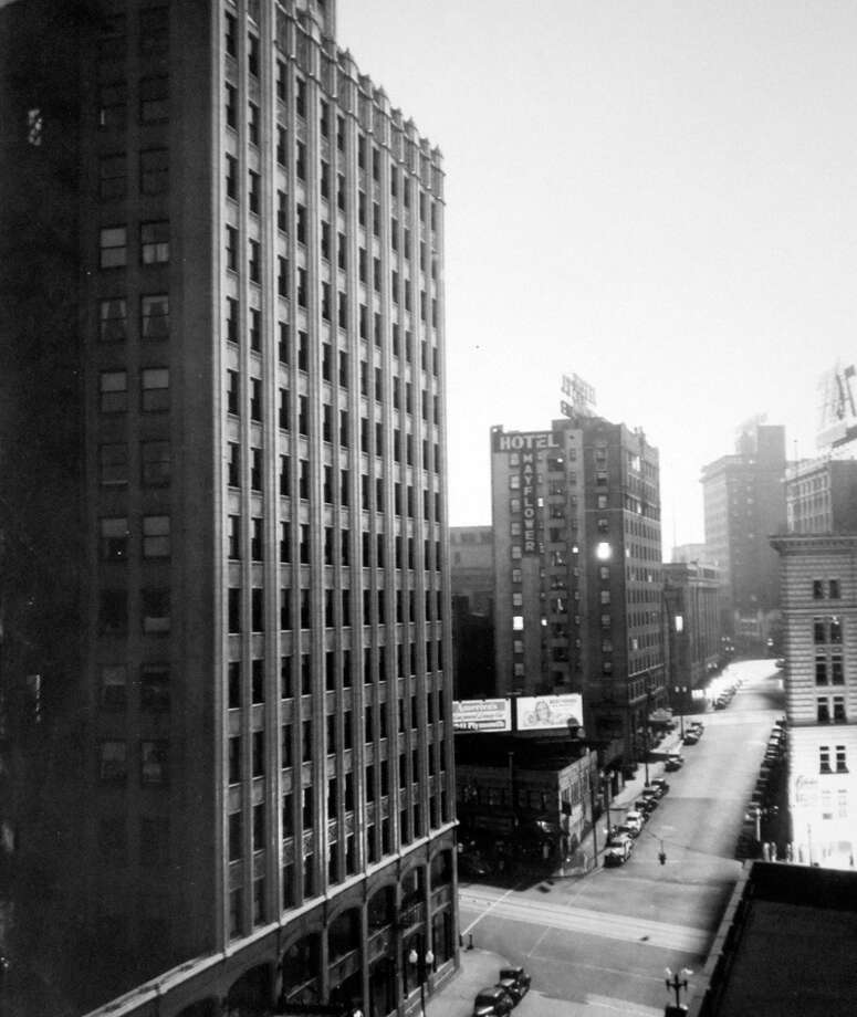 This picture looks west on Olive Way at Westlake during the 1941 blackout, according to notes at MOHAI. It looks like it's daytime because of the long exposure. Photo: MOHAI, Seattle-Post-Intelligencer Collection