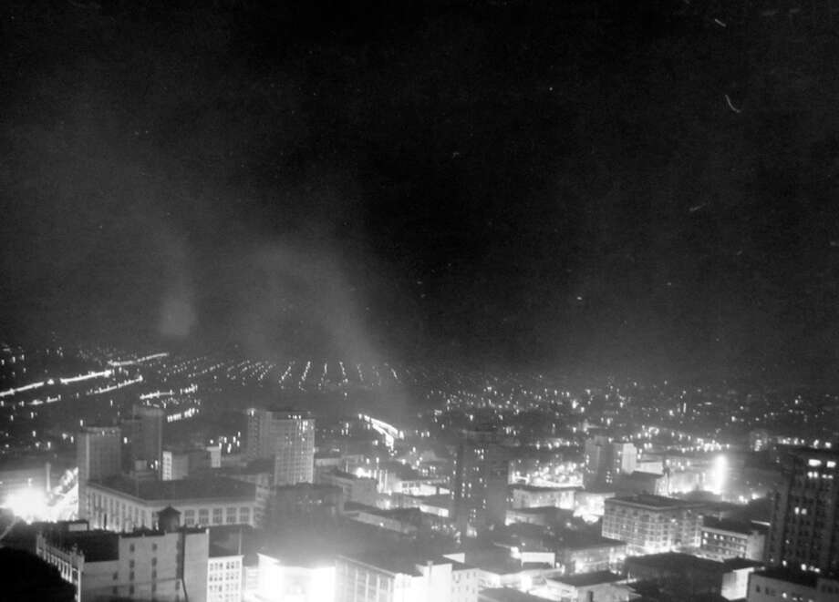 According to notes at MOHAI, this is Seattle during a blackout night in January 1944. The Coliseum, now Banana Republic, is in the foreground, left of center. Street lights create the appearance of more light with the time exposure. Photo: MOHAI, Seattle-Post-Intelligencer Collection