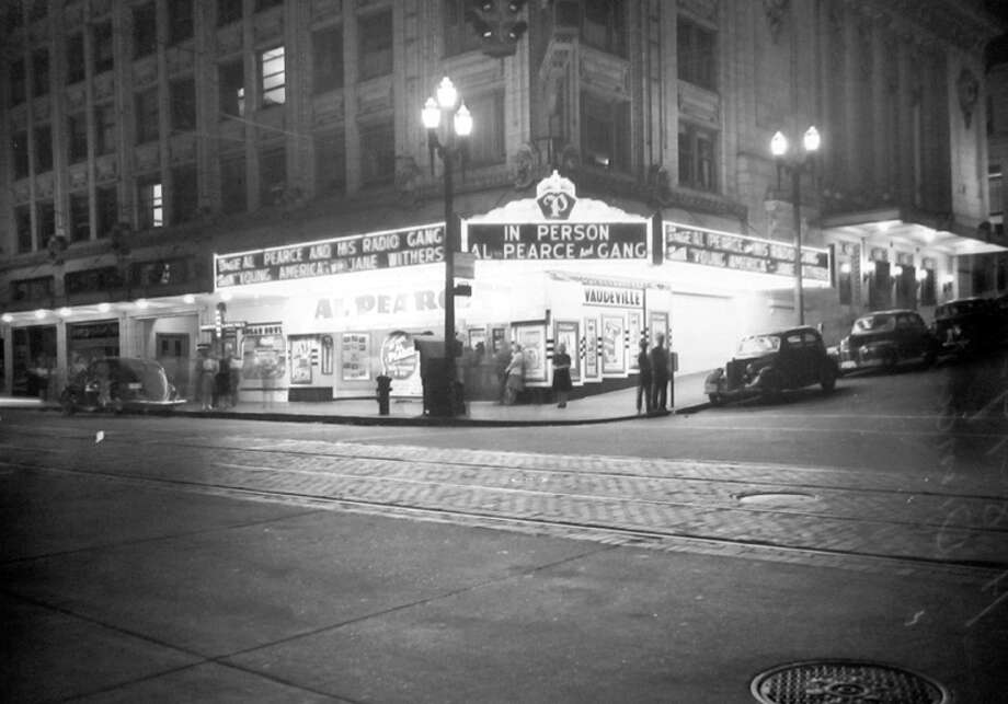 This picture of the Palomar Theatre, 1300 Third Ave., was taken during a blackout night, though clearly not all the lights were off. This image was either taken in December 1941 or August 1942 -- notes on the P-I negative sleeve, which is carefully preserved at MOHAI, aren't clear. Photo: MOHAI, Seattle-Post-Intelligencer Collection