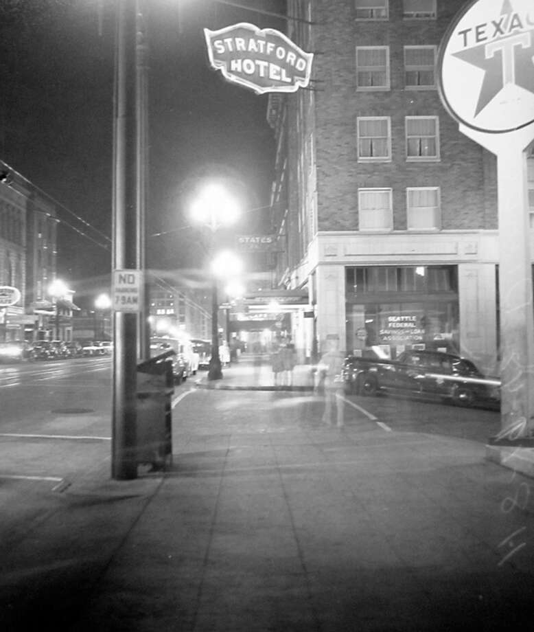 This picture was taken in August 1942 during a blackout night, according to notes at MOHAI. It was taken near Third Avenue and Seneca Street showing the Stratford Hotel and a Texaco station. Photo: MOHAI, Seattle-Post-Intelligencer Collection
