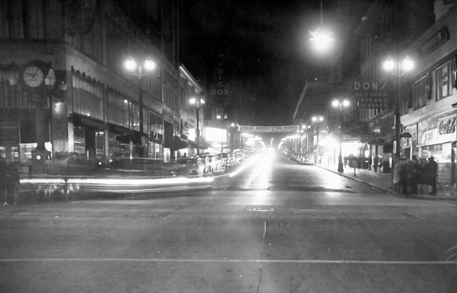 This picture from November 1943 looks south from Pike on Fifth Avenue. The Music Box, which was demolished in the 1990s, is on the left. This was one of the Seattle blackout nights during World War II. Photo: MOHAI, Seattle-Post-Intelligencer Collection