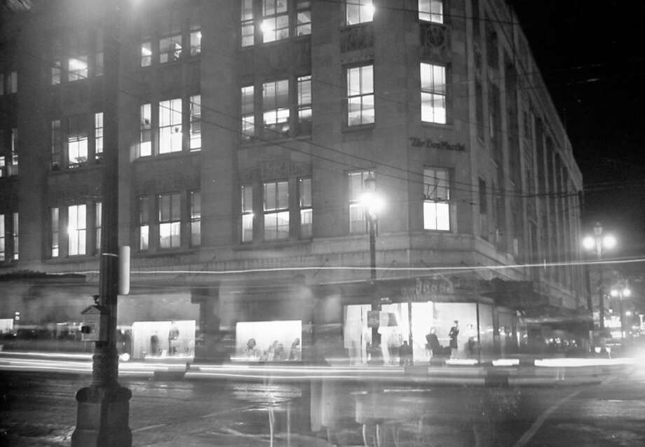 This image, just before a World War II blackout, shows the Bon Marche building that's now Macy's. Photo: MOHAI, Seattle-Post-Intelligencer Collection