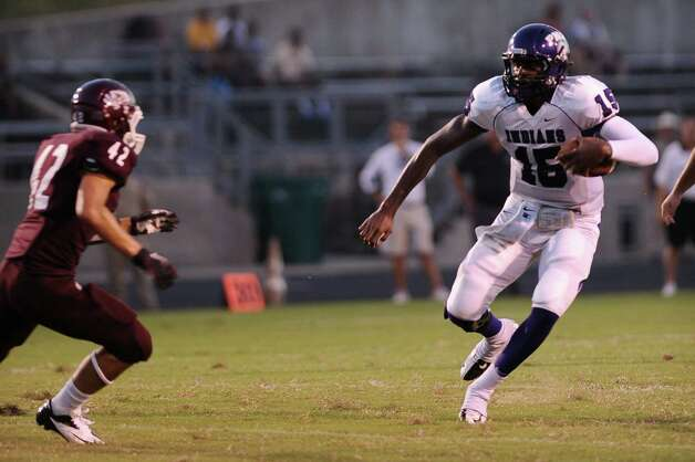 PNG quarterback A.J. Smith makes a run for it. Photo taken at Silsbee High School on Friday, August 31, 2012. Randy Edwards/The Enterprise Photo: Randy Edwards, Photojournalist / Enterprise