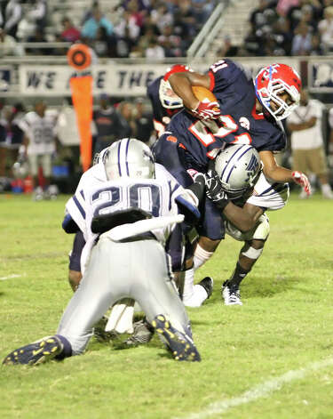 Hardin-Jefferson running back Peyton Gloston, 21, is tackled by a host of West Orange-Stark defenders during the game Friday in Sour Lake. Matt Billiot Photo: Matt Billiot / New