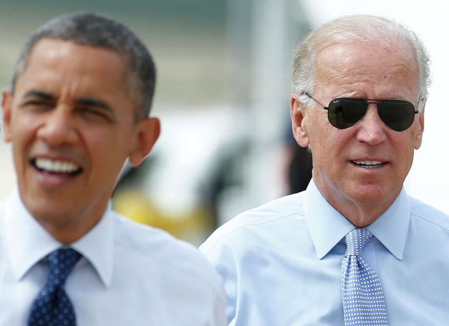 Vice President Joe Biden, right, and President Barack Obama arrive at Portsmouth International Airport at Pease, Friday, Sept. 7, 2012, in Newington, N.H. (AP Photo/Carolyn Kaster) Photo: Ap, STF / New