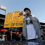 Craig Stammler, of San Francisco has a sign that says it all, as the San Francisco Giants prepare to take on the Detroit Tigers in game two of the World Series, on Wednesday Oct. 24, 2012 at AT&T Park, in  San Francisco, Calif.