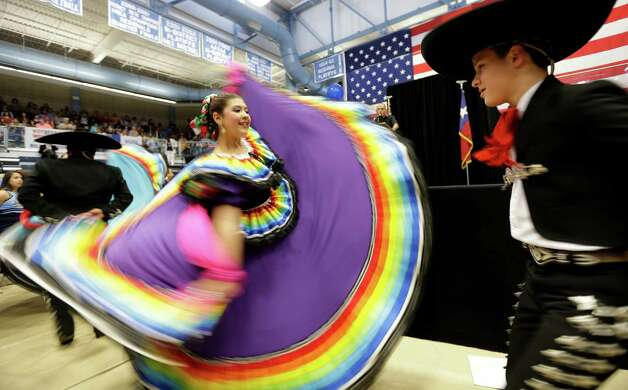Flamenco dancers perform at a Democrat campaign rally, Thursday, Oct. 25, 2012, in San Antonio. Former President Bill Clinton spoke on behalf of fellow democrats at the event. (AP Photo/Eric Gay) Photo: Eric Gay, Associated Press / AP