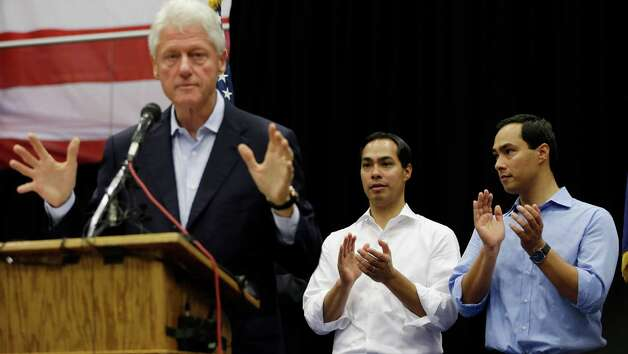 San Antonio Mayor Julian Castro, center, and U.S. congressional hopeful Joaquin Castro, right, listen to former president Bill Clinton during a campaign rally, Thursday, Oct. 25, 2012, in San Antonio. (AP Photo/Eric Gay) Photo: Eric Gay, Associated Press / AP