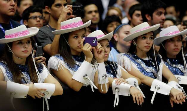 Members of the South San Antonio High School drill team listen as former President Bill Clinton speaks during a campaign rally, Thursday, Oct. 25, 2012, in San Antonio. (AP Photo/Eric Gay) Photo: Eric Gay, Associated Press / AP