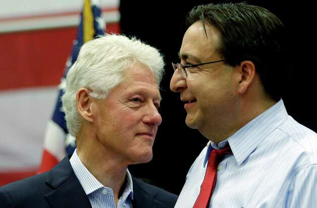 Former President Bill Clinton, left, stands with State Rep. Pete Gallego, D-Alpine, right during a campaign rally, Thursday, Oct. 25, 2012, in San Antonio, where he threw his support for Gallego and U.S. congressional hopeful Joaquin Castro. (AP Photo/Eric Gay) Photo: Eric Gay, Associated Press / AP