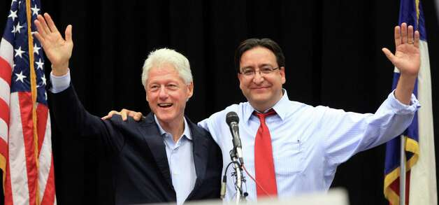 Former President Bill Clinton and Pete Gallego address the crowd at the Democrat Rally at South San High School in San Antonio to show support for Gallego and other Democrats running in the upcoming election.  Thursday, Oct. 25, 2012. Photo: Bob Owen, San Antonio Express-News / San Antonio Express-News