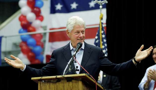 Former President Bill Clinton speaks during a campaign rally, Thursday, Oct. 25, 2012, in San Antonio, where he threw his support for State Rep. Pete Gallego, D-Alpine, and U.S. congressional hopeful Joaquin Castro. (AP Photo/Eric Gay) Photo: Eric Gay, Associated Press / AP