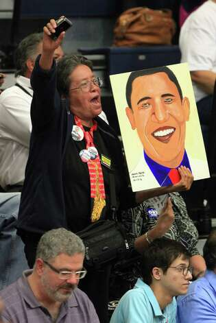 Maria Anita Monsivaiz holds up a painting she did of President Obama at the Democrat Rally with Former President Bill Clinton at South San High School in San Antonio.  Thursday, Oct. 25, 2012. Photo: Bob Owen, San Antonio Express-News / San Antonio Express-News