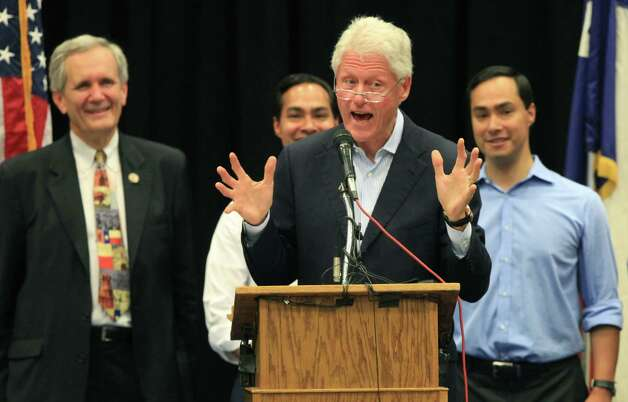 Former President Bill Clinton speaks at South San High School in San Antonio at a Democrat Rally to show support for Democrats running in the upcoming election.  Behind him are Lloyd Doggett, Julian Castro and Joaquin Castro.  Thursday, Oct. 25, 2012. Photo: Bob Owen, San Antonio Express-News / San Antonio Express-News