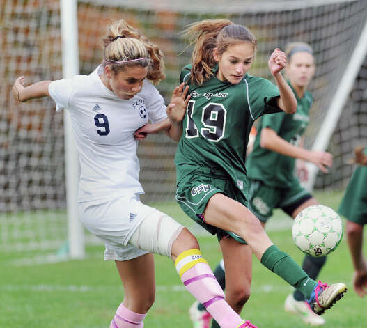At left, Liz Judd # 9 of Rye Country Day School goes for the ball while Elizabeth Mastoloni # 19 of Convent of the Sacred Heart kicks it during the high school soccer match between Convent of the Sacred Heart and Rye Country Day School at Convent in Greenwich, Thursday afternoon, Oct. 25, 2012. Photo: Bob Luckey / Greenwich Time