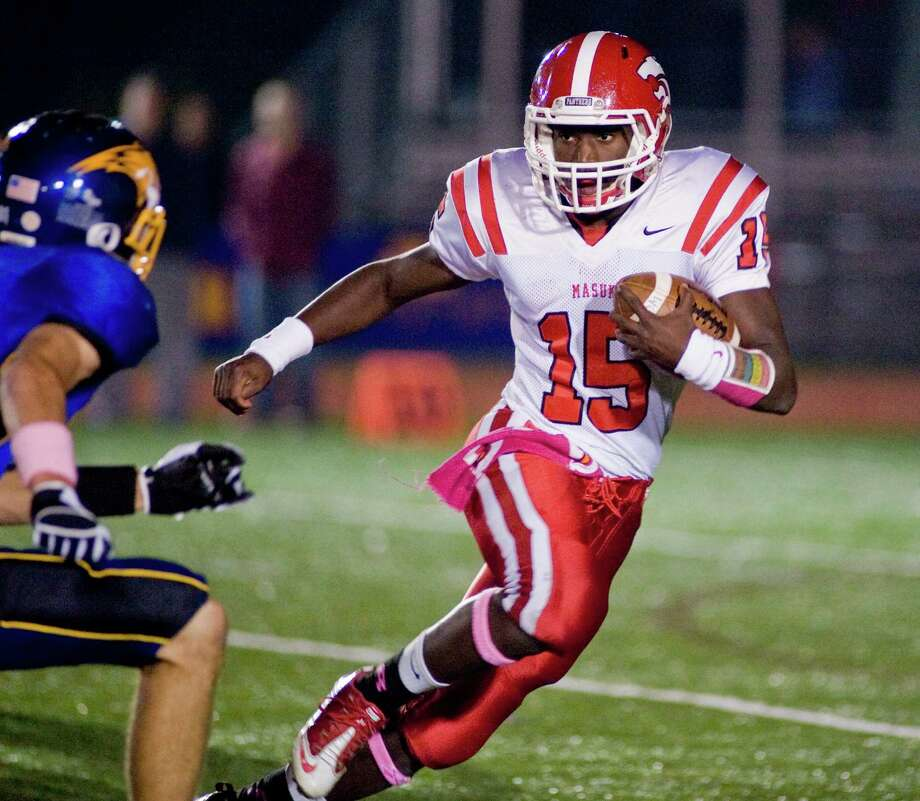 Masuk High School quarterback Malik Cummings evades a tackle during a game against Brookfield High School, played at Brookfield. Saturday, Oct. 20, 2012 Photo: Scott Mullin