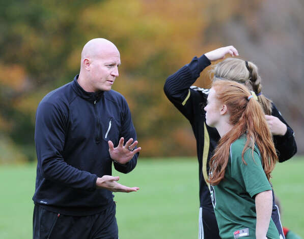 Convent of the Sacred Heart soccer coach Brendan Reidy, left, during the high school soccer match between Convent of the Sacred Heart and Rye Country Day School at Convent in Greenwich, Thursday afternoon, Oct. 25, 2012. Photo: Bob Luckey / Greenwich Time
