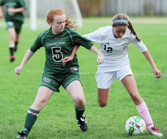 At left, Taylor Ryan # 5 of Convent of the Sacred Heart, goes for the ball against Zoe Kost # 12 of Rye Country Day School during the high school soccer match between Convent of the Sacred Heart and Rye Country Day School at Convent in Greenwich, Thursday afternoon, Oct. 25, 2012. Photo: Bob Luckey / Greenwich Time