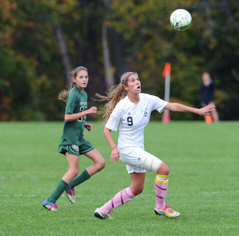 Liz Judd # 9 of Rye Country Day School goes for the header during the high school soccer match between Convent of the Sacred Heart and Rye Country Day School at Convent in Greenwich, Thursday afternoon, Oct. 25, 2012. Photo: Bob Luckey / Greenwich Time