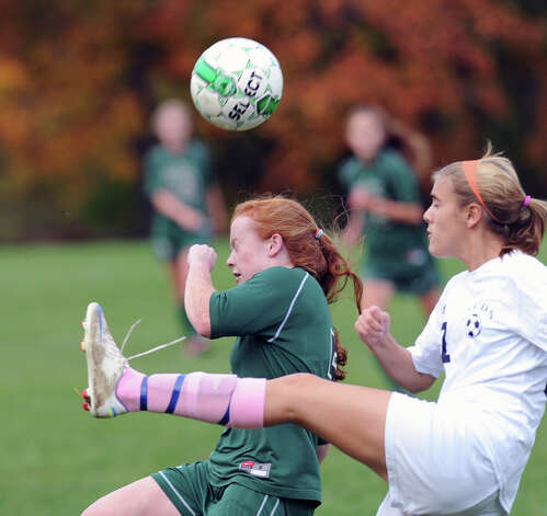 At left, Taylor Ryan of Convent of the Sacred Heart goes for the header as a Rye Country Day School's goes to kick the ball during the high school soccer match between Convent of the Sacred Heart and Rye Country Day School at Convent in Greenwich, Thursday afternoon, Oct. 25, 2012. Photo: Bob Luckey / Greenwich Time
