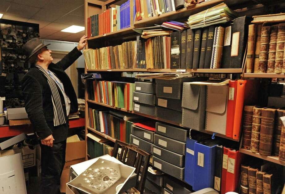Don Rittner, City Historian for Schenectady, looks for a book in Efner History Center in the attic of the Schenectady City Hall in Schenectady, NY on November 17, 2010.  Lori Van Buren / Times Union) Photo: Lori Van Buren / 00011086A