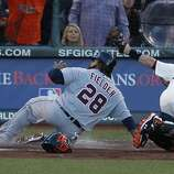 Giants' catcher Buster Posey makes the play at home against Tigers' first baseman Prince Fielder in the 2nd inning during the World Series game 2 at AT&T Park in San Francisco, Calif., on Thursday, Oct. 25, 2012.