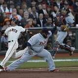Tigers' first baseman Prince Fielder makes the catch at 1st base as Giants' 2nd baseman Marco Scutaro is out during the World Series game 2 at AT&T Park in San Francisco, Calif., on Thursday, Oct. 25, 2012.