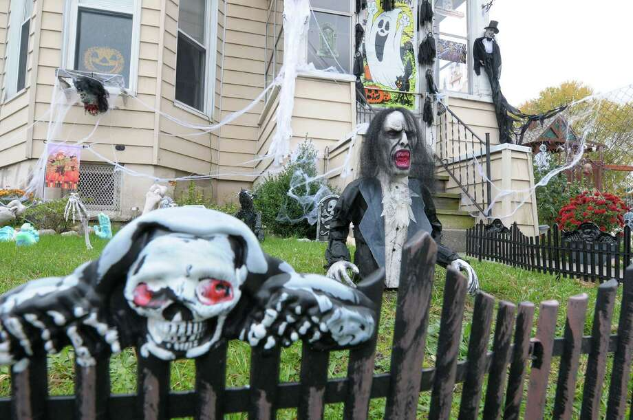 A view of the Halloween decorations at the home of Danielle Casey on Aiken Ave. on Thursday, Oct. 25, 2012 in Rensselaer, NY.  Casey said that she has been adding to her Halloween decorations every year for the past five years to make the display bigger and better.  Casey also puts up a large lawn display for Christmas.  (Paul Buckowski / Times Union) Photo: Paul Buckowski