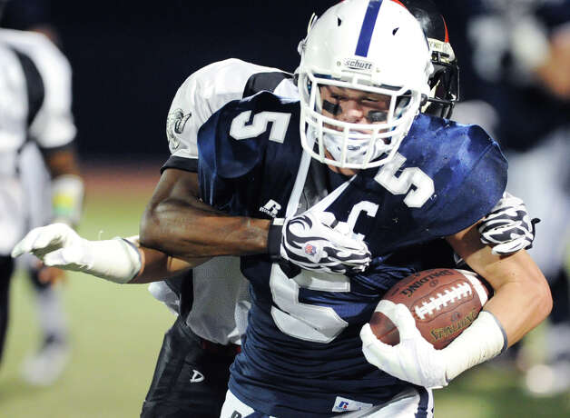 Running back Nicholas Kelly # 5 of Staples heads upfield during high school football game between Staples High School and Bridgeport Central High School at Staples in Westport, Friday night, Sept. 21, 2012. Photo: Bob Luckey / Greenwich Time