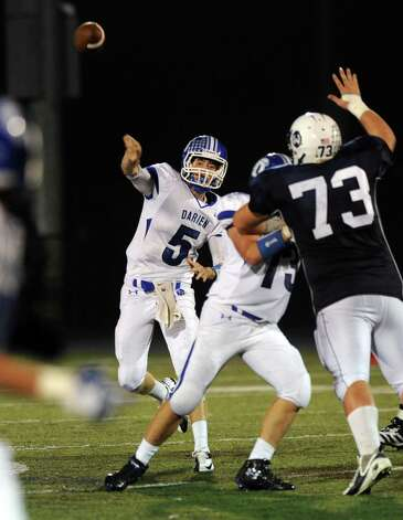 Darien's Henry Baldwin throws a pass during Friday's football game at Wilton High School on October 19, 2012. Photo: Lindsay Niegelberg