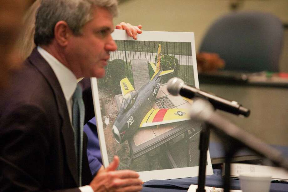U.S. Rep.  Michael McCaul, R-Austin, displays an example of the kind of remote-controlled aircraft used as drones for surveillance during Thursday's forum. Photo: Eric Kayne / Eric Kayne