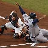 Giants' catcher Buster Posey makes the play at the plate against Tigers' first baseman Prince Fielder in the 2nd inning during game 2 of the World Series at AT&T Park on Thursday, Oct. 25, 2012 in San Francisco, Calif.