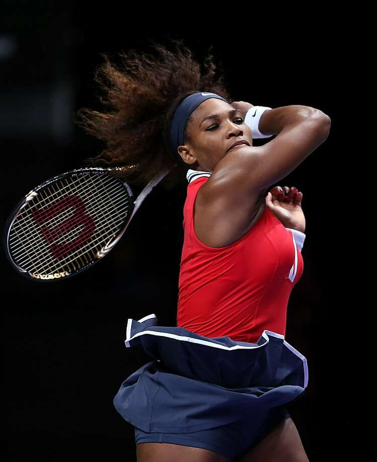 Serena Williams hits a forehand en route to her ninth straight win over Victoria Azarenka. Photo: Julian Finney, Getty Images