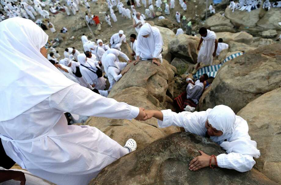 Muslim pilgrims climb a rocky hill called the Mountain of Mercy on the Plain of Arafat near the holy city of Mecca, Saudi Arabia, Thursday, Oct. 25, 2012. Saudi authorities say around 3.4 million pilgrims, some 1.7 million of them from abroad, have arrived in the holy cities of Mecca and Medina for this year's pilgrimage. (AP Photo/Hassan Ammar) Photo: Hassan Ammar, Associated Press / AP