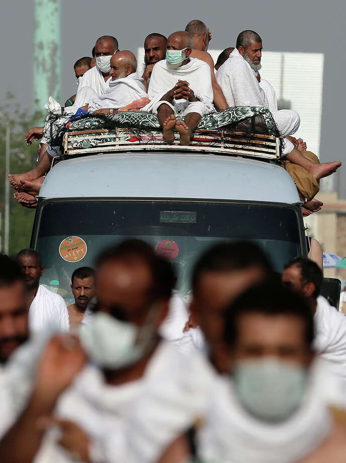 Muslim pilgrims head to Mount Arafat ahead of the hajj main ritual in the holy city of Mecca, Saudi Arabia, Thursday, Oct. 25, 2012.  (AP Photo/Hassan Ammar) Photo: Hassan Ammar, Associated Press / AP