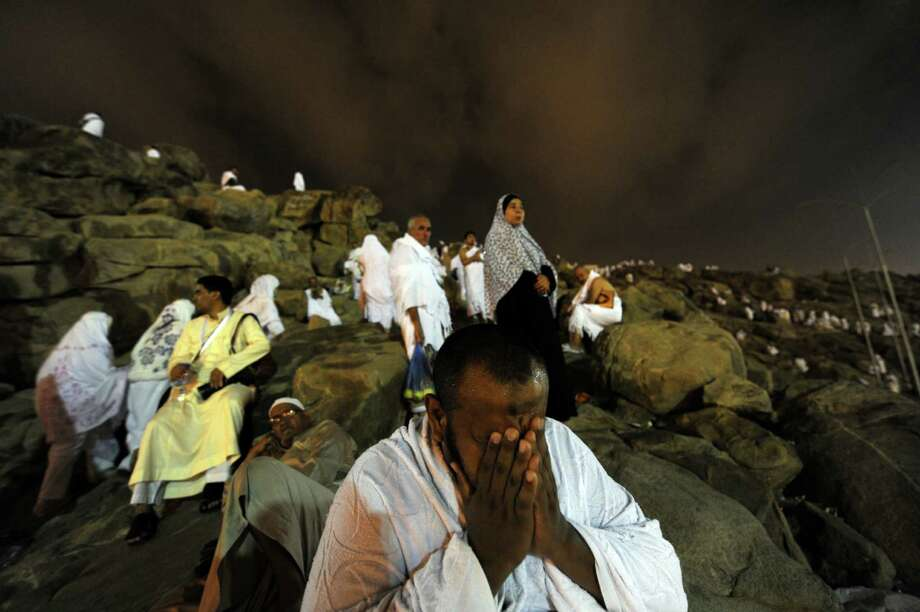 A Muslim pilgrim prays on Mount Arafat near the holy city of Mecca, on October  24, 2012. The annual hajj pilgrimage started in earnest today, with more than two million Muslims thronging roads on foot and by bus for a five-day journey of faith most have spent their entire lives waiting for. AFP PHOTO/FAYEZ NURELDINE Photo: FAYEZ NURELDINE, AFP/Getty Images / AFP