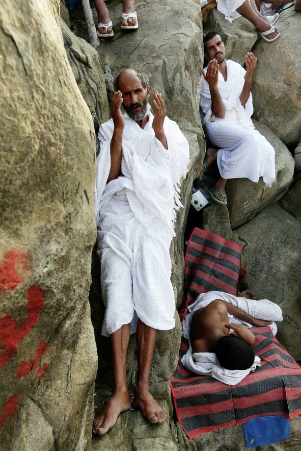 Muslim pilgrimS pray on a rocky hill called the Mountain of Mercy, on the Plain of Arafat near the holy city of Mecca, Saudi Arabia, Thursday, Oct. 25, 2012.  (AP Photo/Hassan Ammar) Photo: Hassan Ammar, Associated Press / AP