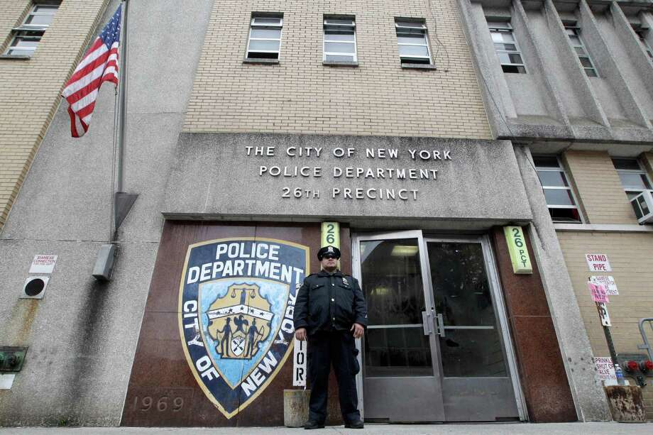 A police officer stands guard outside the 26th precinct where police officer Gilberto Valle worked out of, Thursday, Oct. 25, 2012 in New York. Valle was charged Thursday in a ghoulish plot to kidnap and torture women and then cook and eat their body parts. (AP Photo/Mary Altaffer) Photo: Mary Altaffer