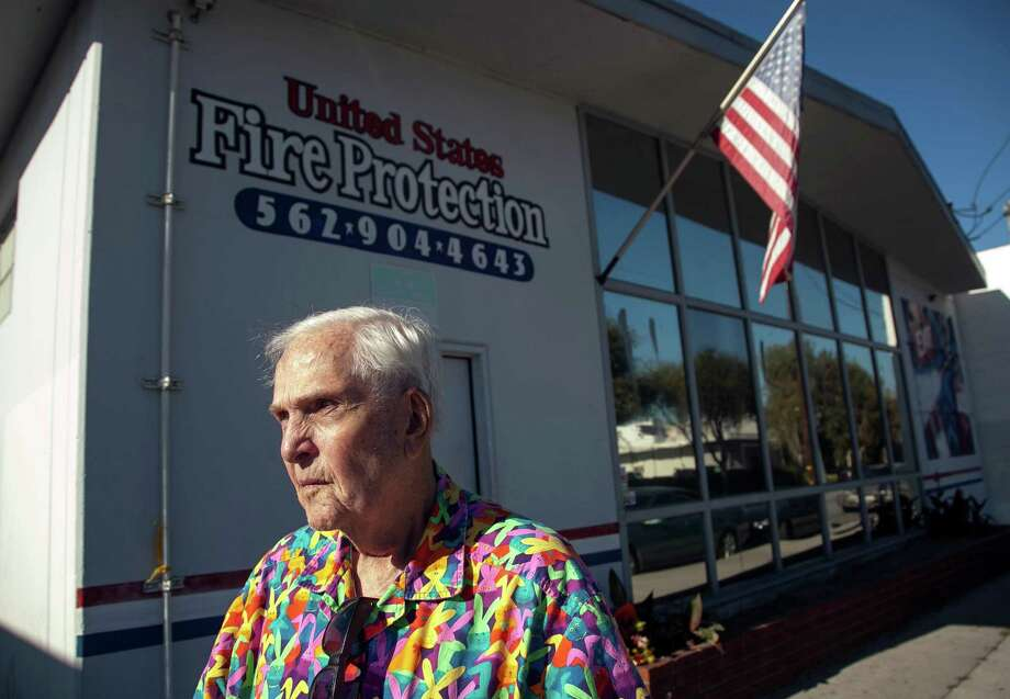 Business owner Dean Wright, 82, pauses outside his neighbor's family-owned business, United States Fire Protection Services, in Downey, Calif. Thursday, Oct. 25, 2012. A gunman killed three people and injured two, including a 13-year-old boy, Wednesday in two separate attacks on a family at their business, United States Fire Protection Services and nearby residence. Police say the five family members who were shot had been targeted by the gunman.  (AP Photo/Damian Dovarganes) Photo: Damian Dovarganes