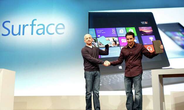 IMAGE DISTRIBUTED FOR MICROSOFT - Windows president Steven Sinofsky, left, and Panos Panay, general manager for Surface Computing, introduce Microsoft's Surface as it makes its much-anticipated debut, Thursday, Oct. 25, 2012 in New York. (Jason DeCrow/AP Images for Microsoft) Photo: Jason DeCrow
