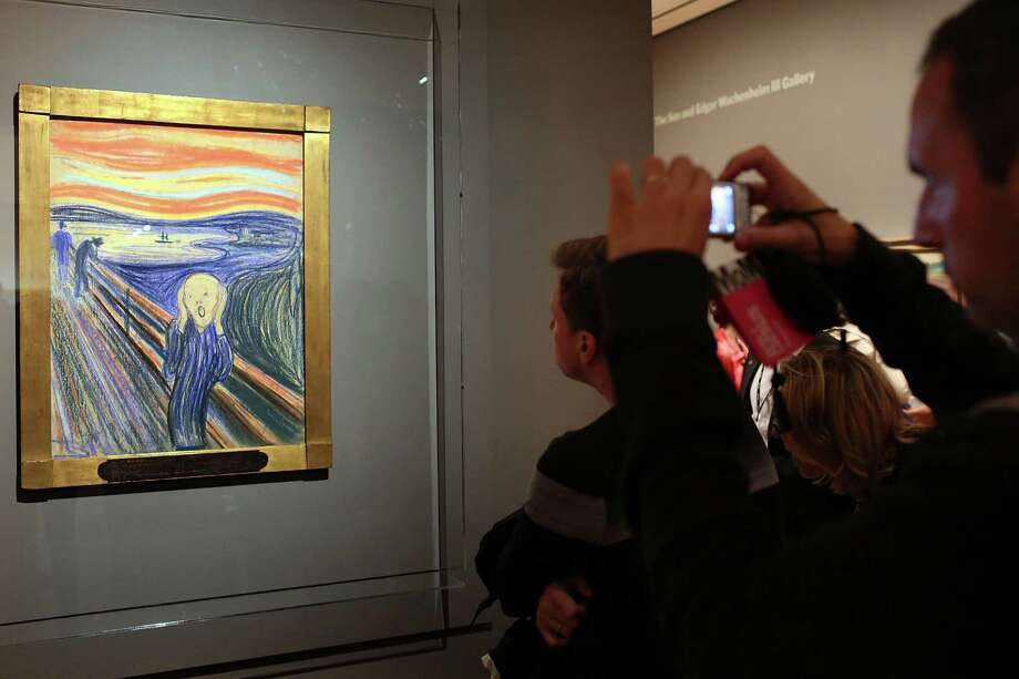 "NEW YORK, NY - OCTOBER 25:  People look at Edvard Munch's ""The Scream,"" which went on display in Manhattan's Museum of Modern Art  (MOMA) for a six-month exhibition October 25, 2012 in New York City. The Norwegian artist's most famous motif, and one of the world's most iconic paintings, sold for nearly $120 million at Sotheby's auction house in May and is the only one of four versions that is in private hands.  (Photo by Spencer Platt/Getty Images) Photo: Spencer Platt"