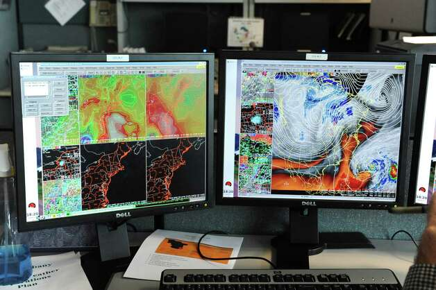 Maps on meteorologist's computer screens track Hurricane Sandy at the National Weather Service on Fuller Rd. on Thursday, Oct. 25, 2012 in Albany, N.Y.  (Lori Van Buren / Times Union) Photo: Lori Van Buren