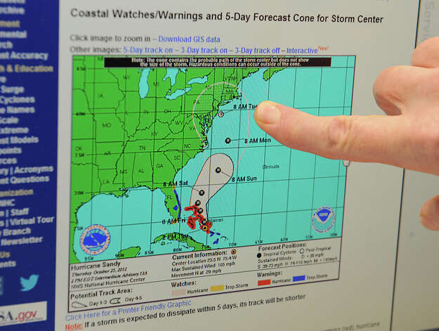 Meteorologist Hugh Johnson points to the forecast cone of Hurricane Sandy on a computer map at the National Weather Service on Fuller Rd. on Thursday, Oct. 25, 2012 in Albany, N.Y. This is the predicted path zone for the hurricane as of the time this photo was taken. (Lori Van Buren / Times Union) Photo: Lori Van Buren
